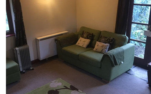Keepers Nook cottage accommodation lounge showing one of two sofas