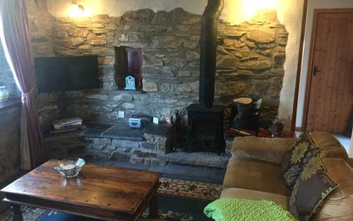 Wood burner and flat screen tv in the old chapel cottage dinas country club